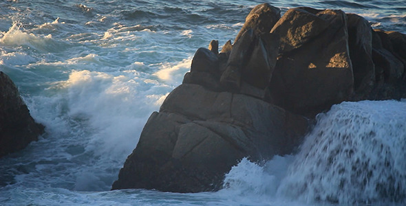 VideoHive Wave Crashes on Large Ocean Rock 10117724