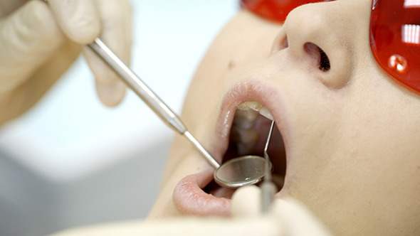 VideoHive Woman Being Under Dentists Examination 10119306