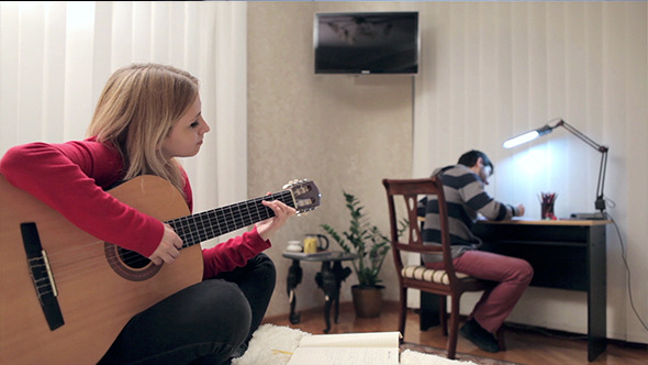 VideoHive Girl Playing At Guitar In Her Home 10119697