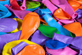 Colorful deflated balloons on the desk - PhotoDune Item for Sale