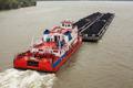 Tugboat Pushing a Heavy Barge - PhotoDune Item for Sale
