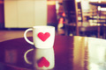 vintage color tone of  cup of coffee with red heart on the table - PhotoDune Item for Sale