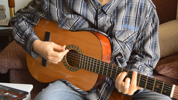 VideoHive Man Playing An Acoustic Guitar 10125003