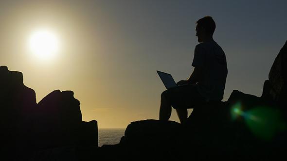 VideoHive Man on Laptop under Golden Sunshine 10131359