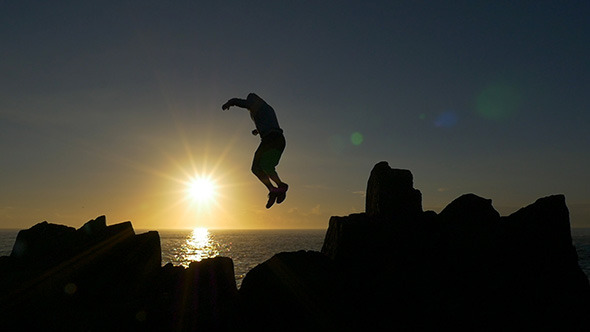 VideoHive Jumping Across Rocks at Sunrise 10131985