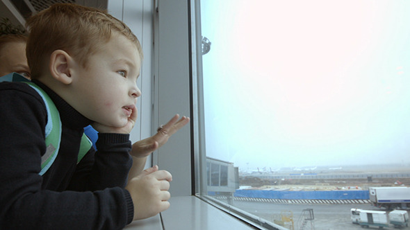 VideoHive Mother And Son At Airport Spending Time Looking 10133464