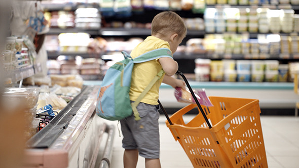 VideoHive Boy Putting Products Into Shopping Cart 10133601