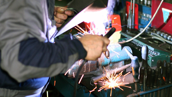 VideoHive Welder with Welding Electrode on the Workbench 10135210