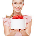Young Happy Smiling Woman With A Gift In Hands. Focus On The Gift. Isolated On White Background. - PhotoDune Item for Sale