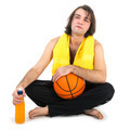 Man sitting on floor with basketball and orange juice, isolated at white - PhotoDune Item for Sale