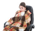 Woman with blanket sitting in armchair, isolated over white - PhotoDune Item for Sale