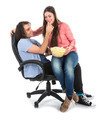Man and woman sitting together in armchair eating pop corn - PhotoDune Item for Sale