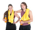 Man and woman in sports wear relaxing with orange juice, isolated over white - PhotoDune Item for Sale