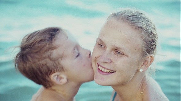 VideoHive Boy Kissing Mother While Bathing In The Sea 10143694