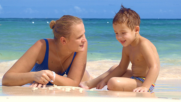 VideoHive Boy Watching Mother Drawing On Sand 10143739