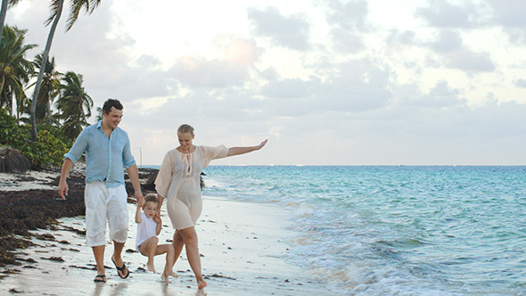 VideoHive Parents And Child Walking Along The Beach Holding 10143751