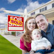Happy Young Military Family in Front of Sold Real Estate Sign and New House. - PhotoDune Item for Sale