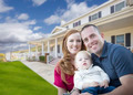 Happy Young Military Family in Front of Their Beautiful House. - PhotoDune Item for Sale