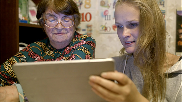 VideoHive Young And Senior Woman Looking Through Photos 10147960