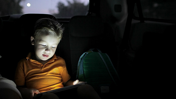 VideoHive Little Boy Using Tablet Pc During Car Travel 10147974