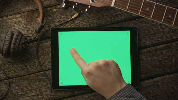 VideoHive Musician Using Tablet PC in Landscape Mode 10149996