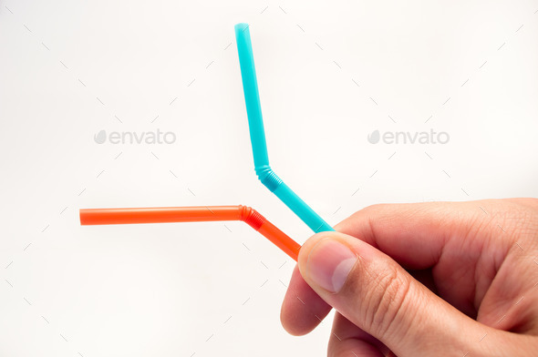 holding two straws