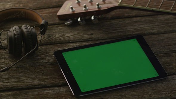 VideoHive Tablet PC with Green Screen Laying on Wooden Table 10150100