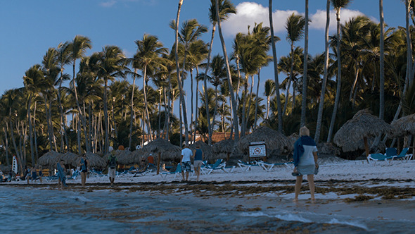 VideoHive People Walking Along The Beach On Tropical Resort 10150127