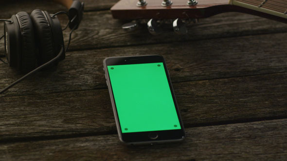 VideoHive Phone in Portrait Mode Laying on Wooden Table 10150129