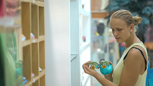 VideoHive Woman In The Shop Looking At Decorative Thing 10150194