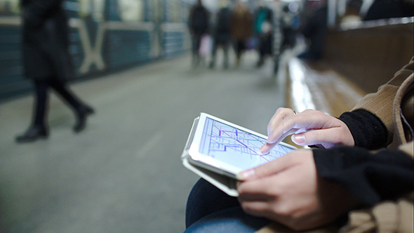 VideoHive Woman In Metro Looking At Undeground Map On Pad 10151045
