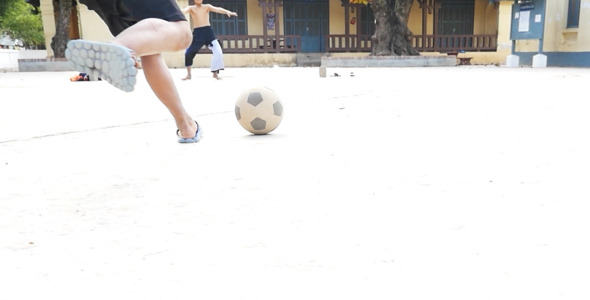 VideoHive Kid Running and Shooting A Ball 10151595