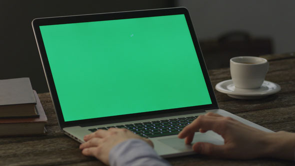 VideoHive Using Notebook with Green Screen at Home 10152406