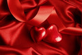 Red hearts on satin background - PhotoDune Item for Sale