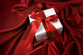 Small valentine gift on red satin - PhotoDune Item for Sale