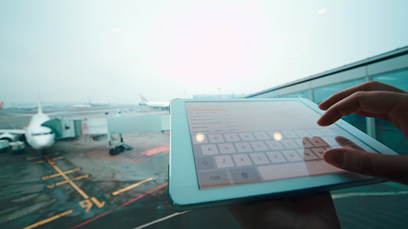 VideoHive Using Tablet Computer By The Window At Airport 10156644