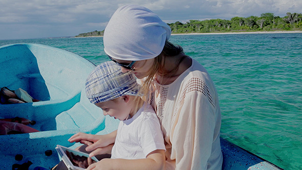 VideoHive Mother And Son Using Pad While Traveling By Sea 10156830