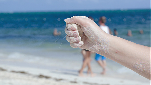 VideoHive Sand Pouring From Female Hand 10156994