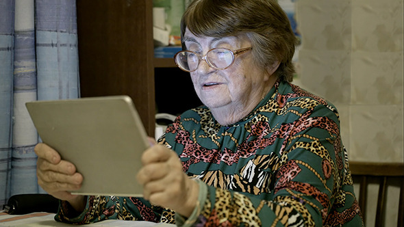 VideoHive Senior Woman Using Touch Pad And Talking 10162353