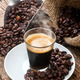 Espresso coffee in glass cup with coffee beans. - PhotoDune Item for Sale