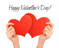 Holiday valentine background with hands holding two red hearts.  - PhotoDune Item for Sale