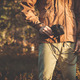 Young Man with retro photo camera outdoor hipster Lifestyle - PhotoDune Item for Sale