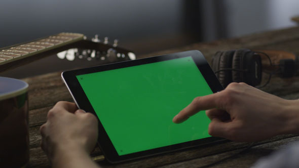 Musician Using Tablet PC in Landscape Mode