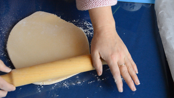 Woman Rolls The Dough