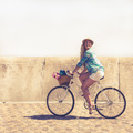Cute blonde on a bike ride on a sunny day - PhotoDune Item for Sale