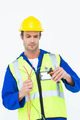 Handsome electrician cutting wire with pliers over white background