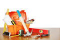 Plastic box with various working tools stands on a wooden table against white background - PhotoDune Item for Sale
