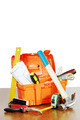 Plastic toolbox with various working tools stands on a wooden table against white background - PhotoDune Item for Sale