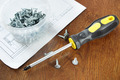 Screwdriver with screws on the wooden table - PhotoDune Item for Sale