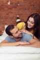 Playful affectionate couple relaxing at home - PhotoDune Item for Sale